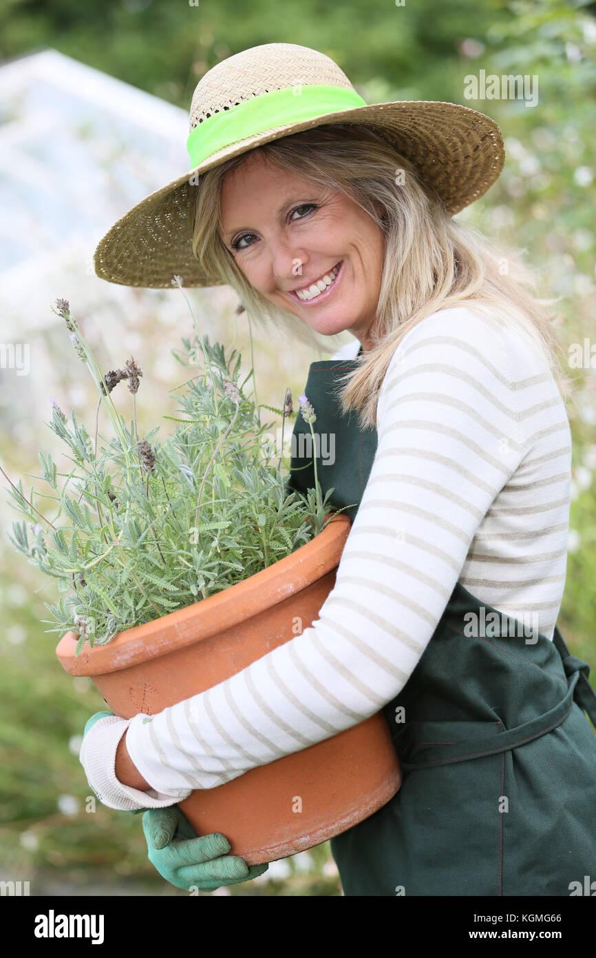 Portrait of beautiful woman gradening aromatic plants Stock Photo