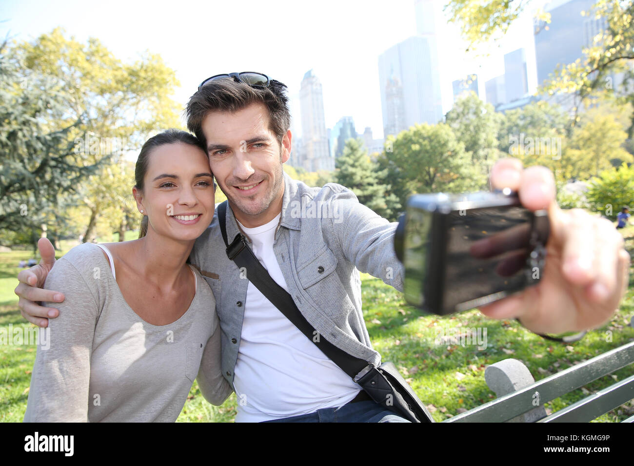 Couple in Central Park taking picture of themselves Stock Photo