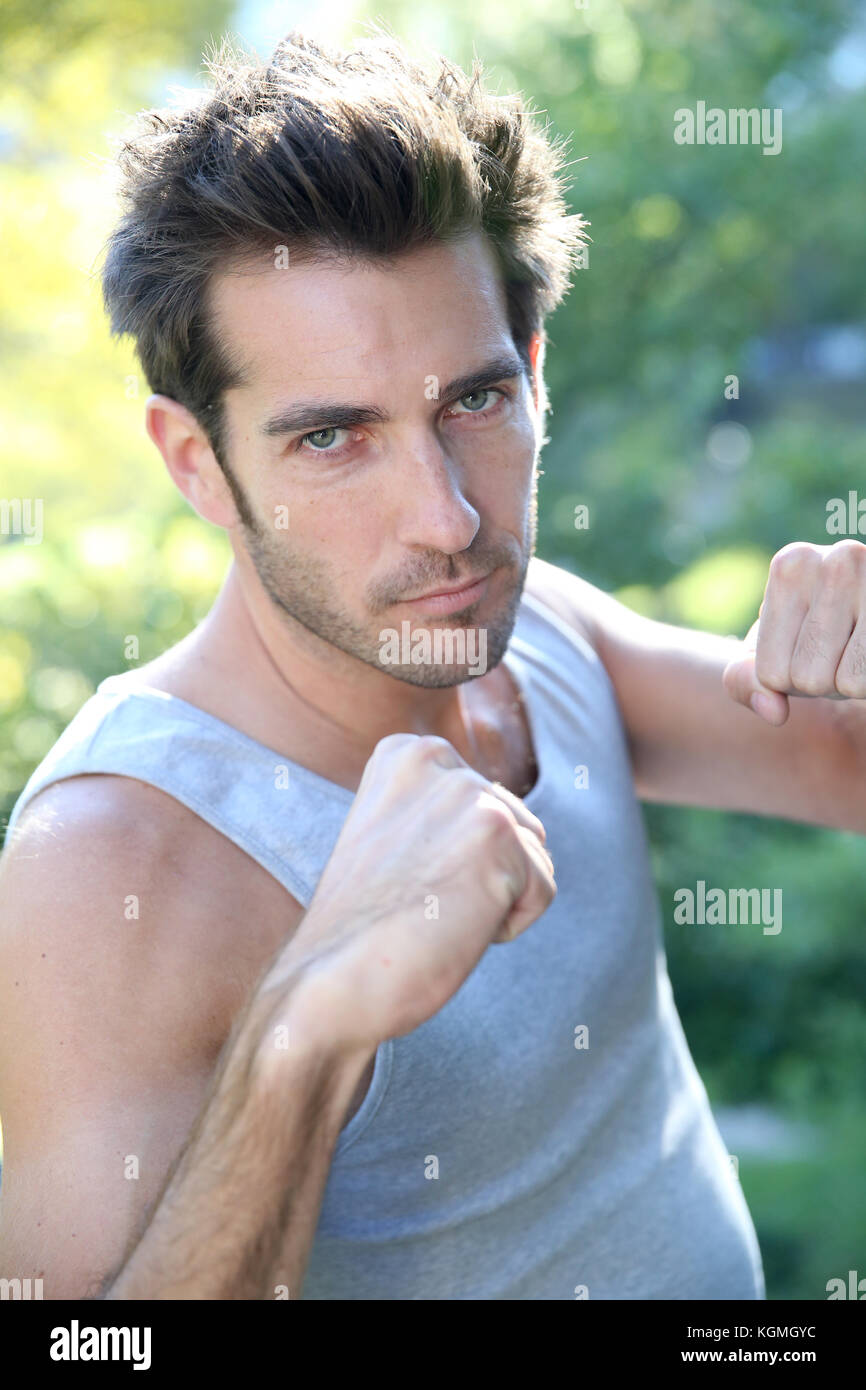 Athletic man working out in Central Park - Stock Image