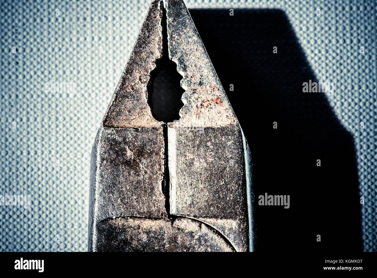 iron nipper over canvas - still life wallpaper - Stock Image