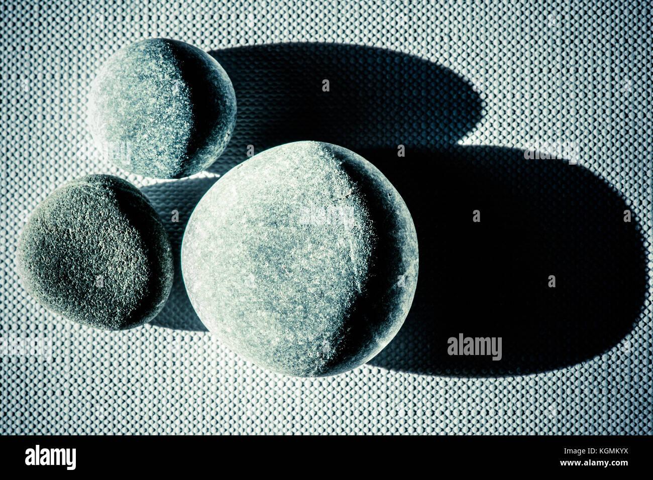 Zen Stones Over Canvas Still Life Wallpaper Stock Photo