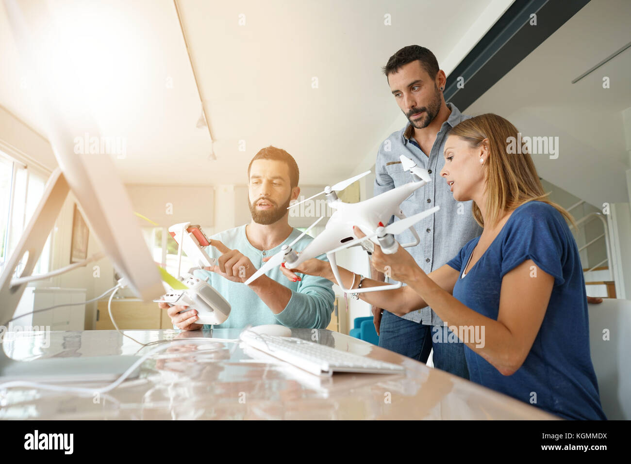 Startup people in office working on drone technology - Stock Image