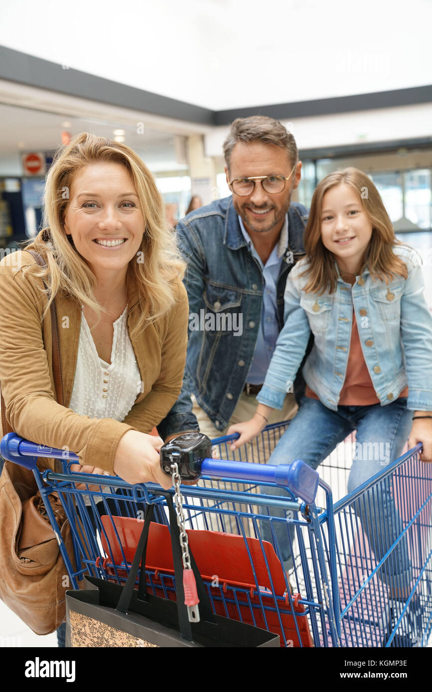 Portrait of happy family going to the grocery store - Stock Image