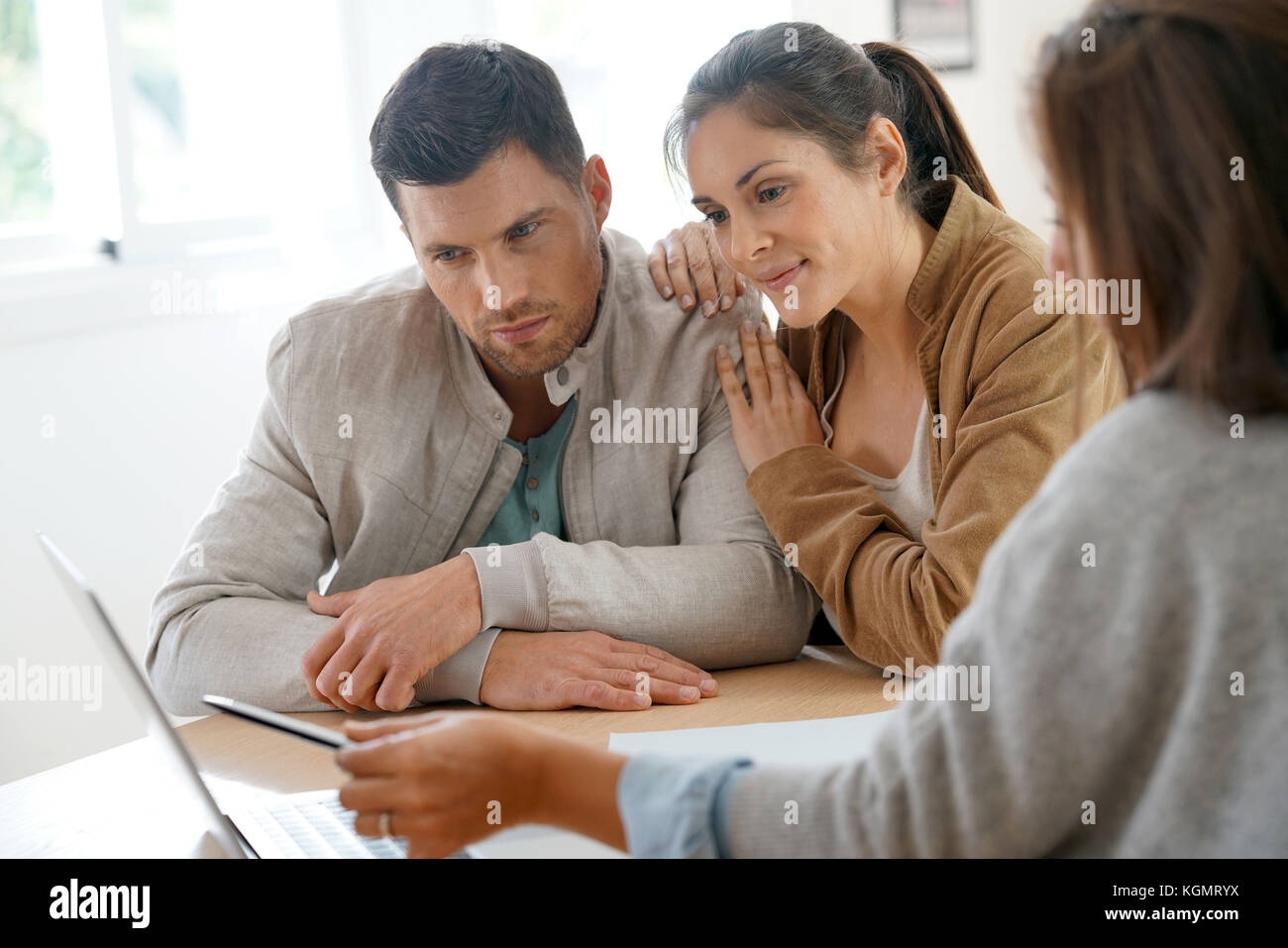 Couple meeting architect for future home designing - Stock Image