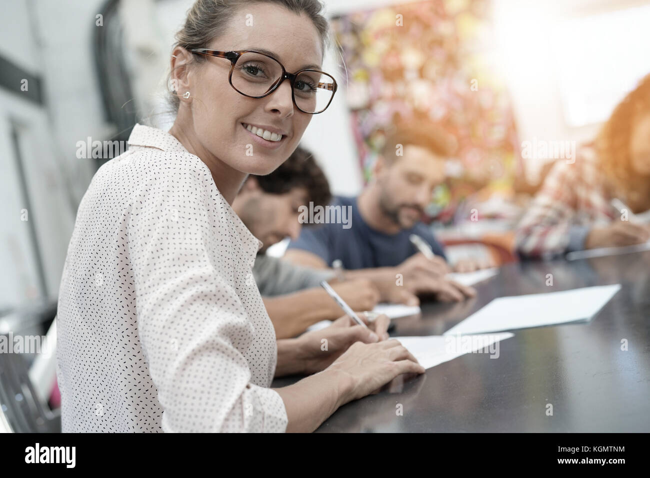 University students filling in application form - Stock Image