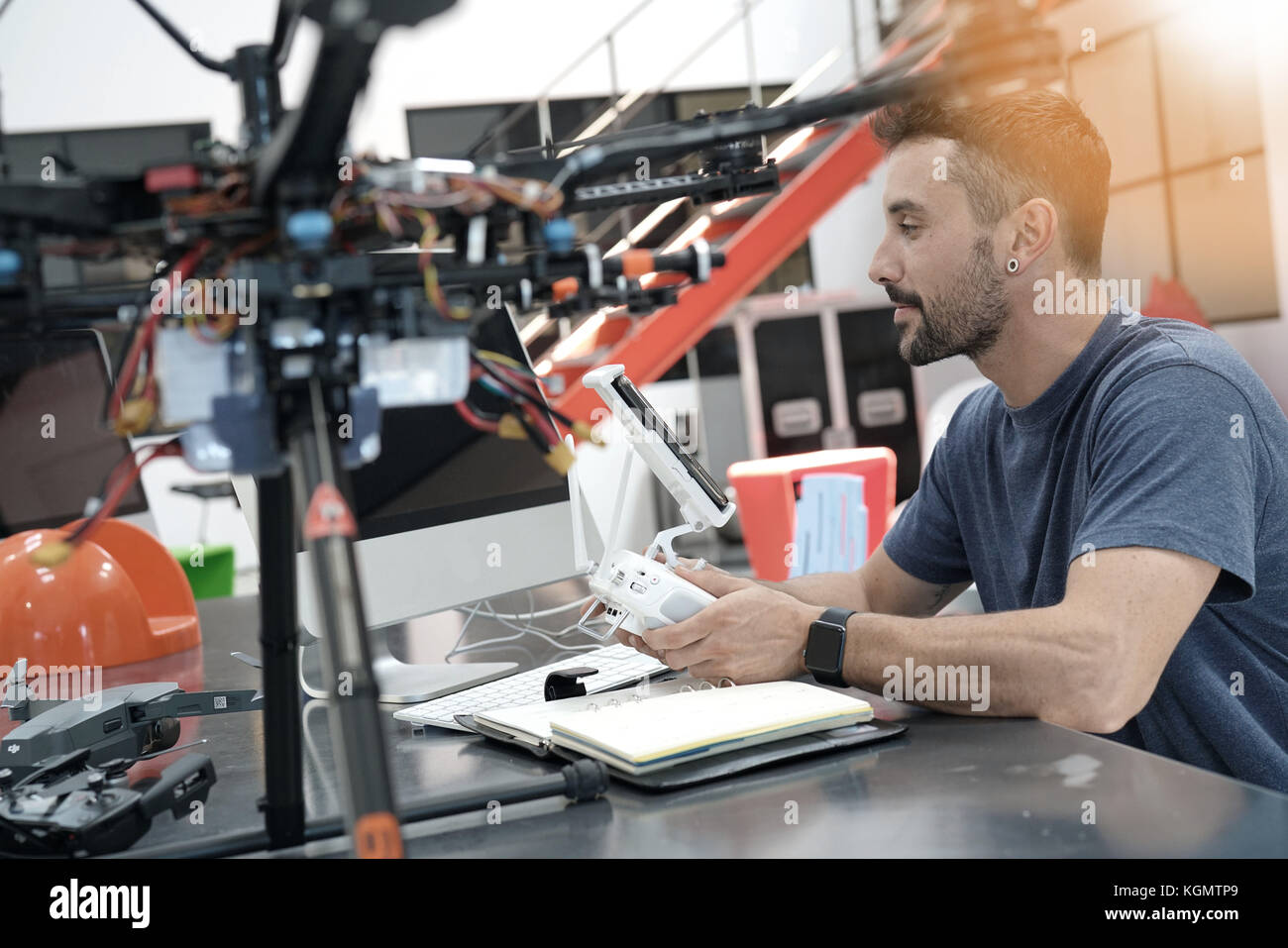 Engineer working on drone in lab - Stock Image