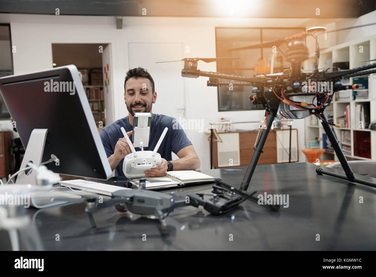 Engineer working on drone in office Stock Photo