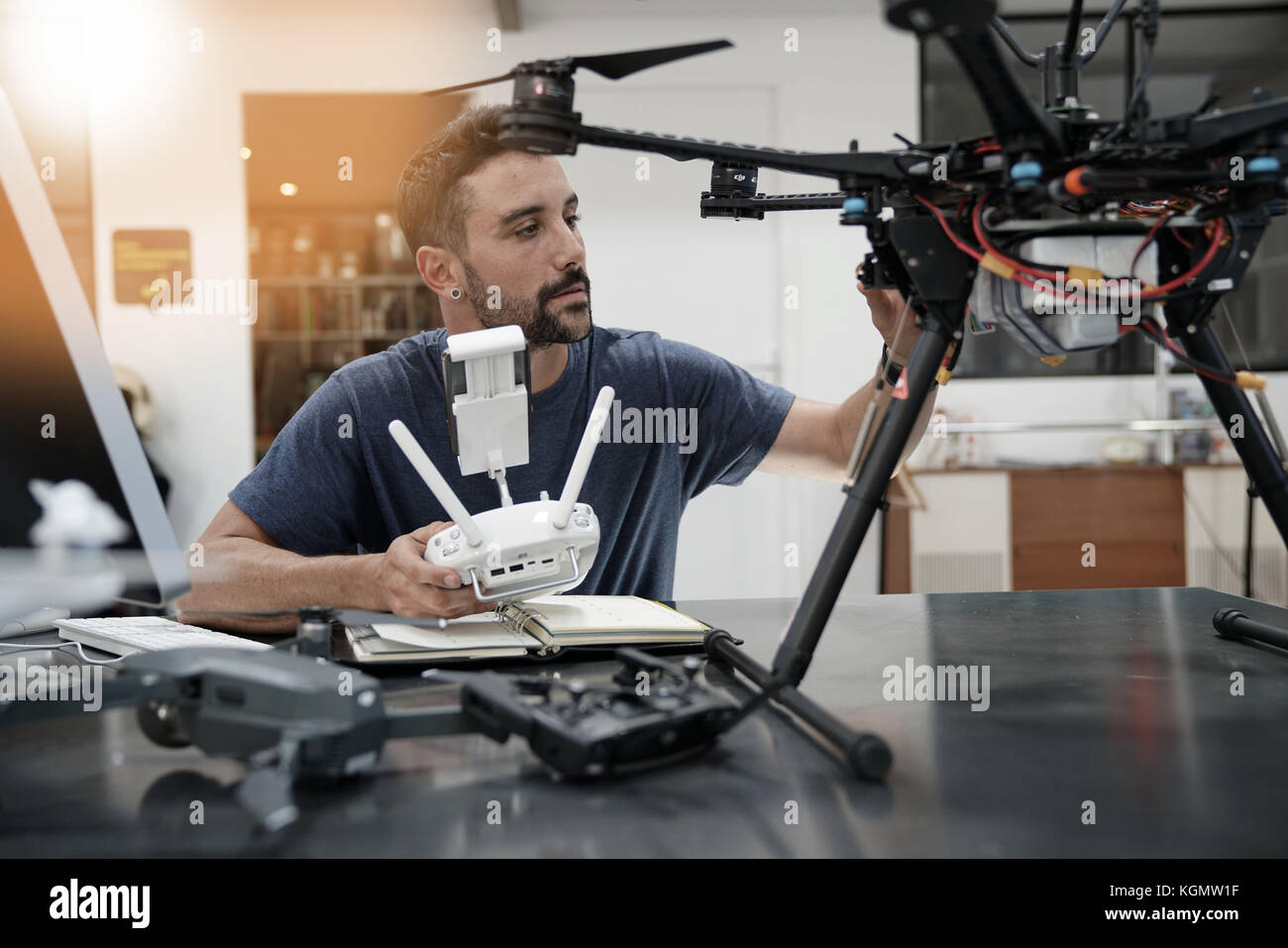 Engineer working on drone in office - Stock Image
