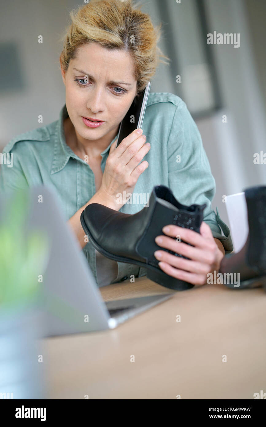 Woman on the phone with customer service department - Stock Image