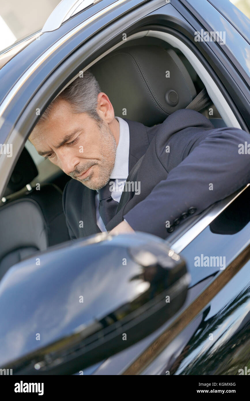 Private driver inside car waiting for client Stock Photo