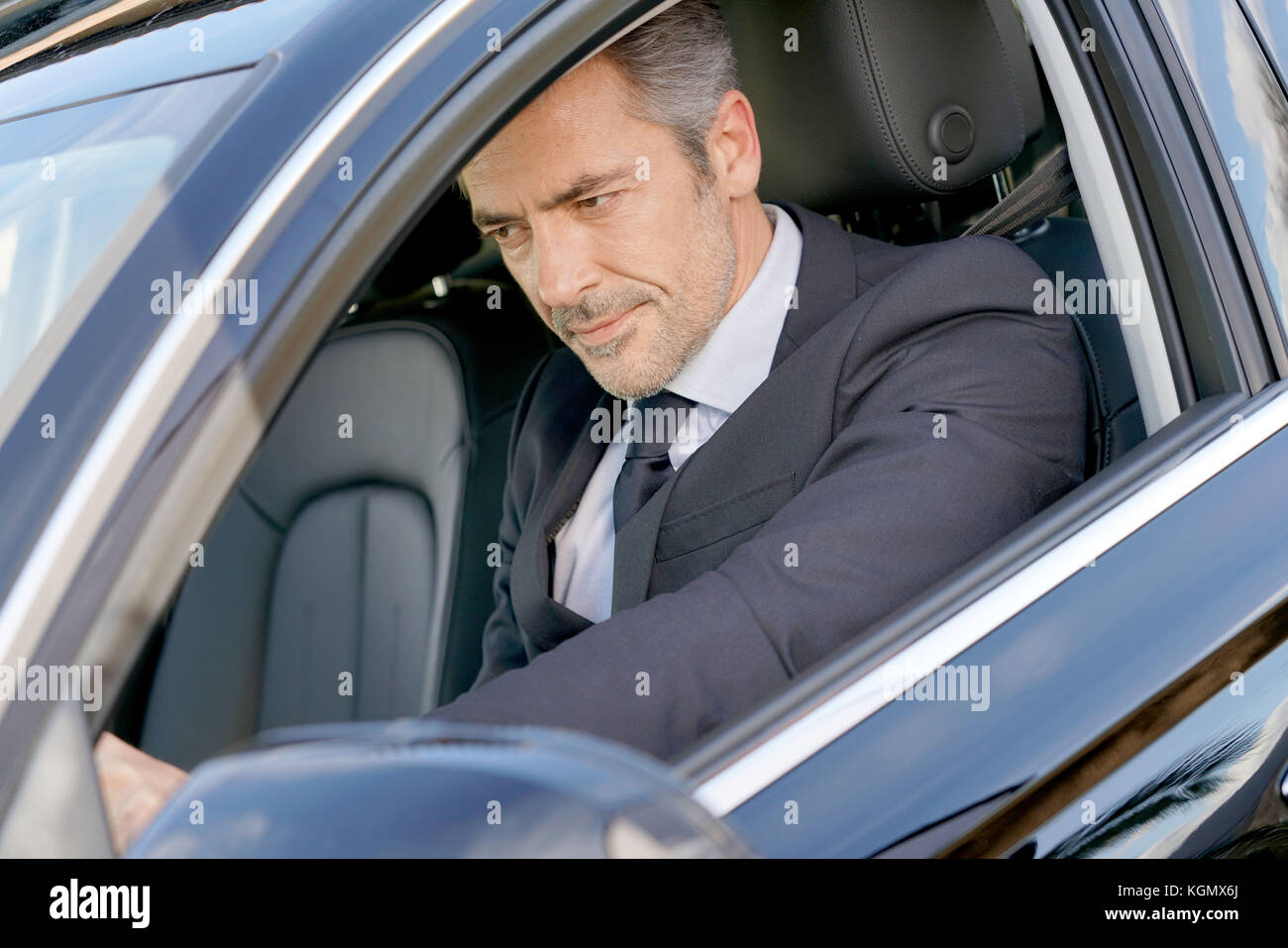 Private driver inside car waiting for client - Stock Image