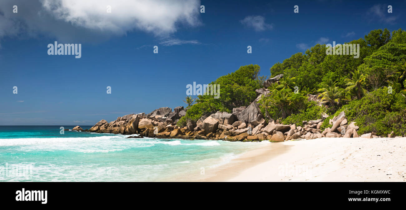 The Seychelles, La Digue, Petit Anse, beach, eroded granite rock formation in sea , panoramic Stock Photo