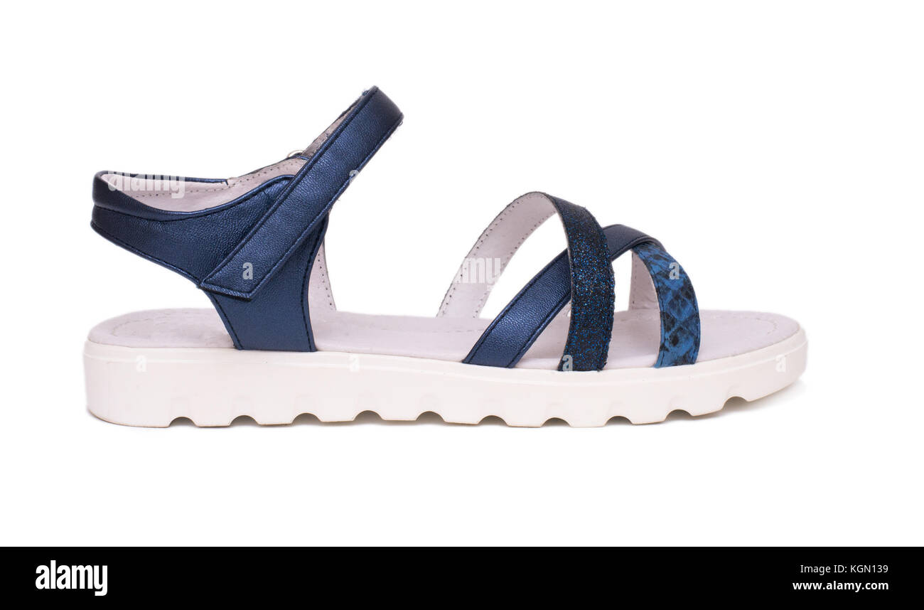 Blue female sandals isolated on white background - Stock Image