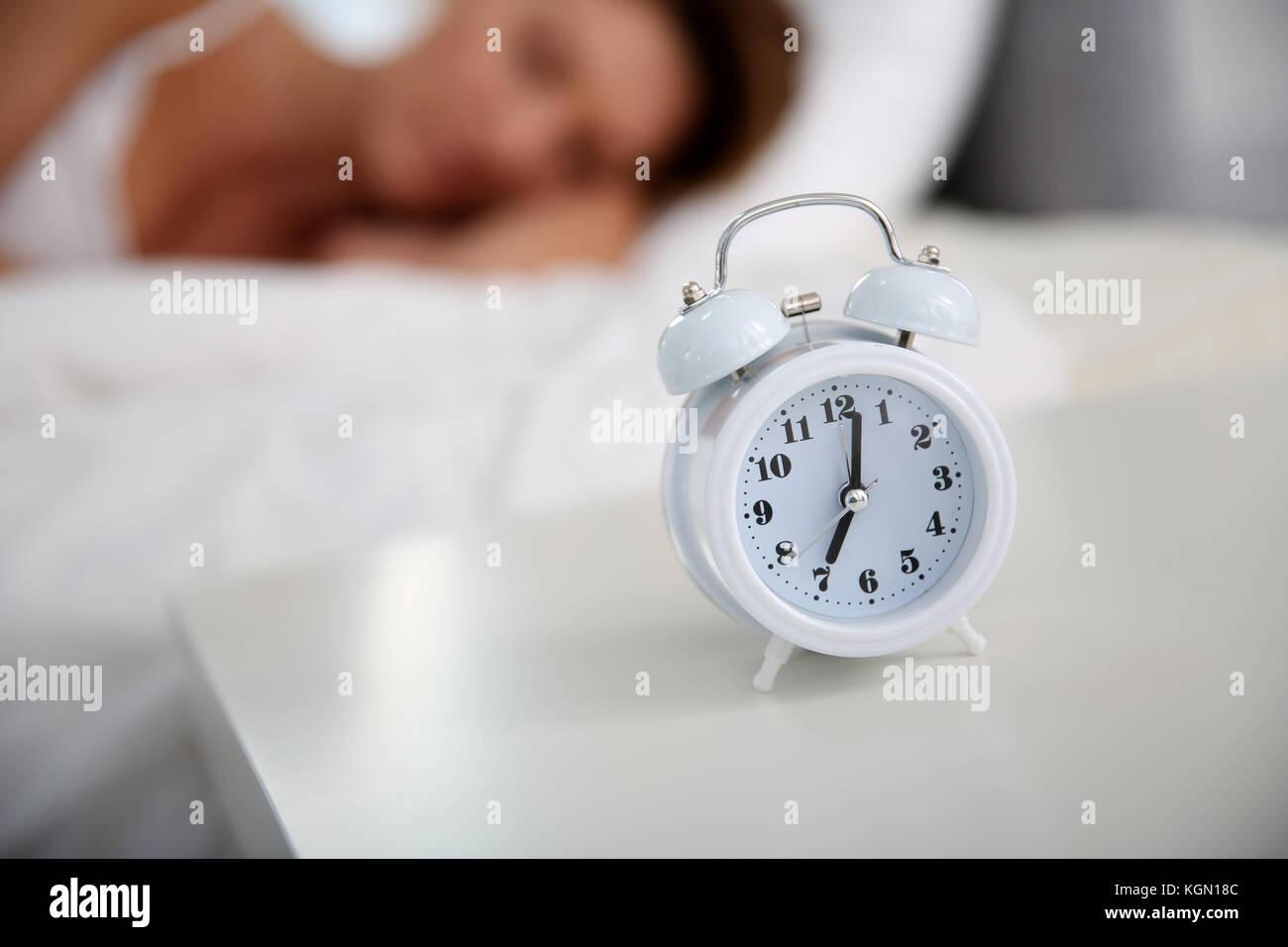 Closeup of alarm clock set on bedroom table Stock Photo: 165189820 ...