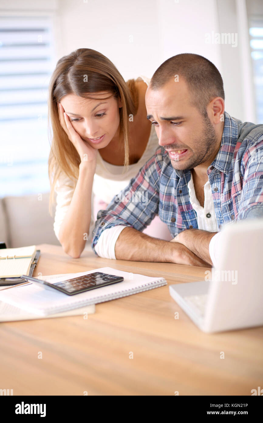 Couple being worried about their budget - Stock Image