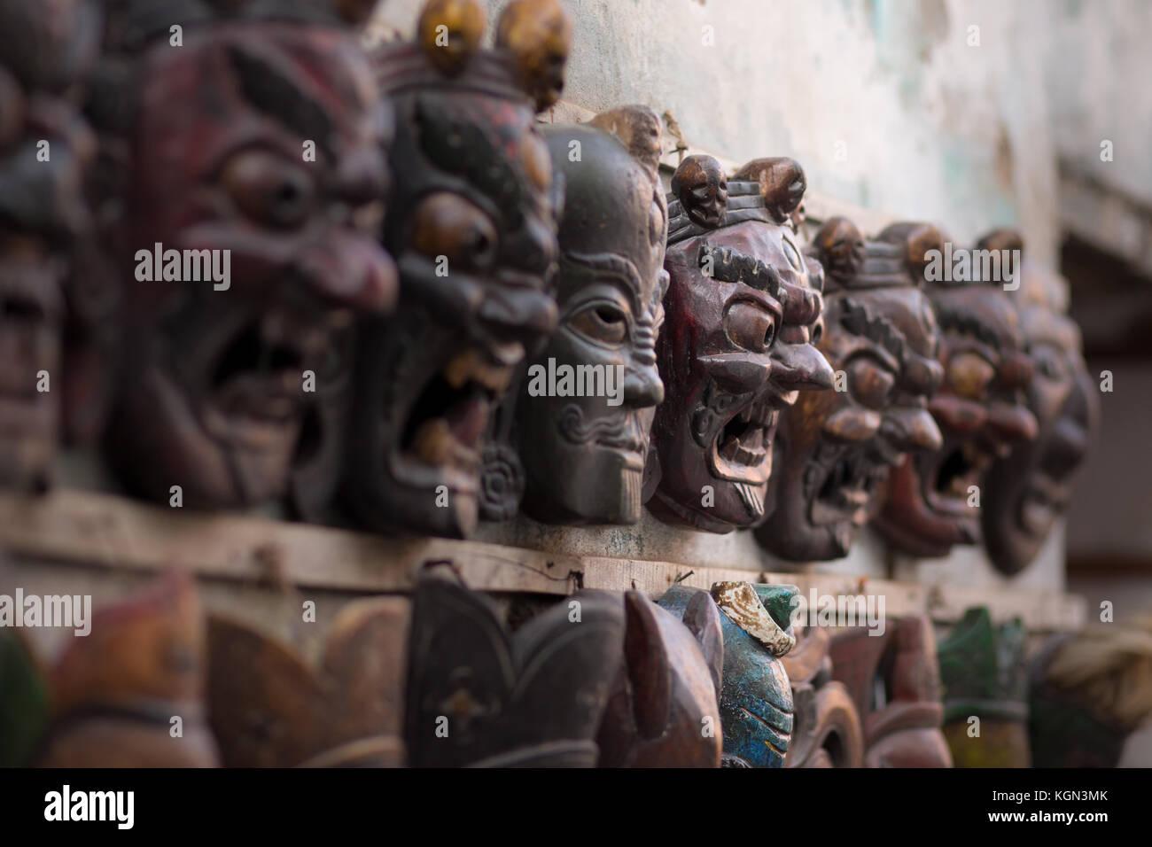 Masks on display along the street in Kathmandu, Nepal - Stock Image
