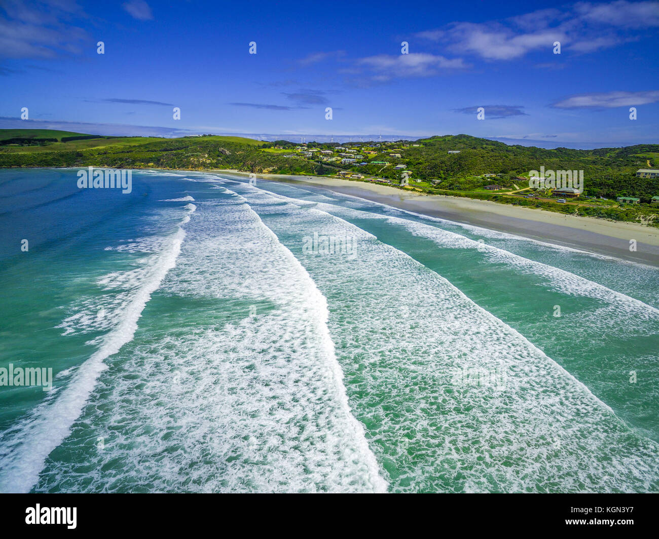 Aerial view of crushing ocean waves and white sandy beach - Stock Image