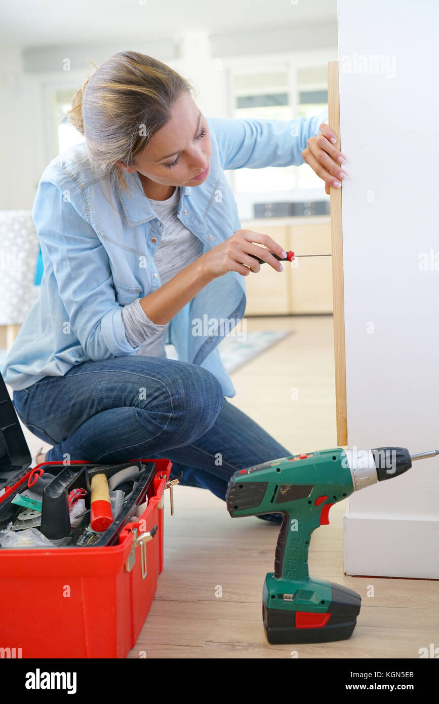 Woman doing DIY work at home - Stock Image