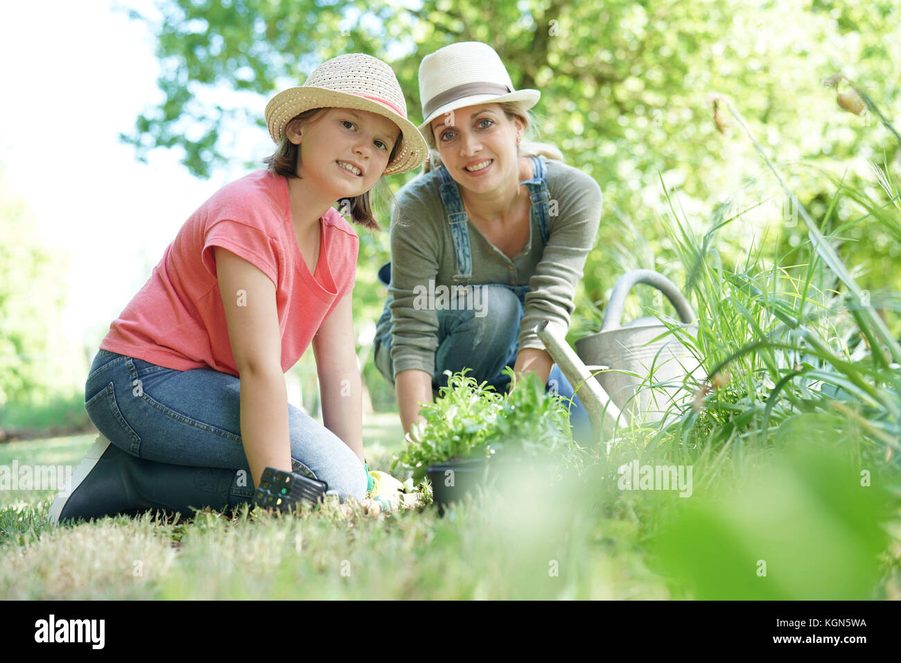 Mother and daughter gardening together - Stock Image