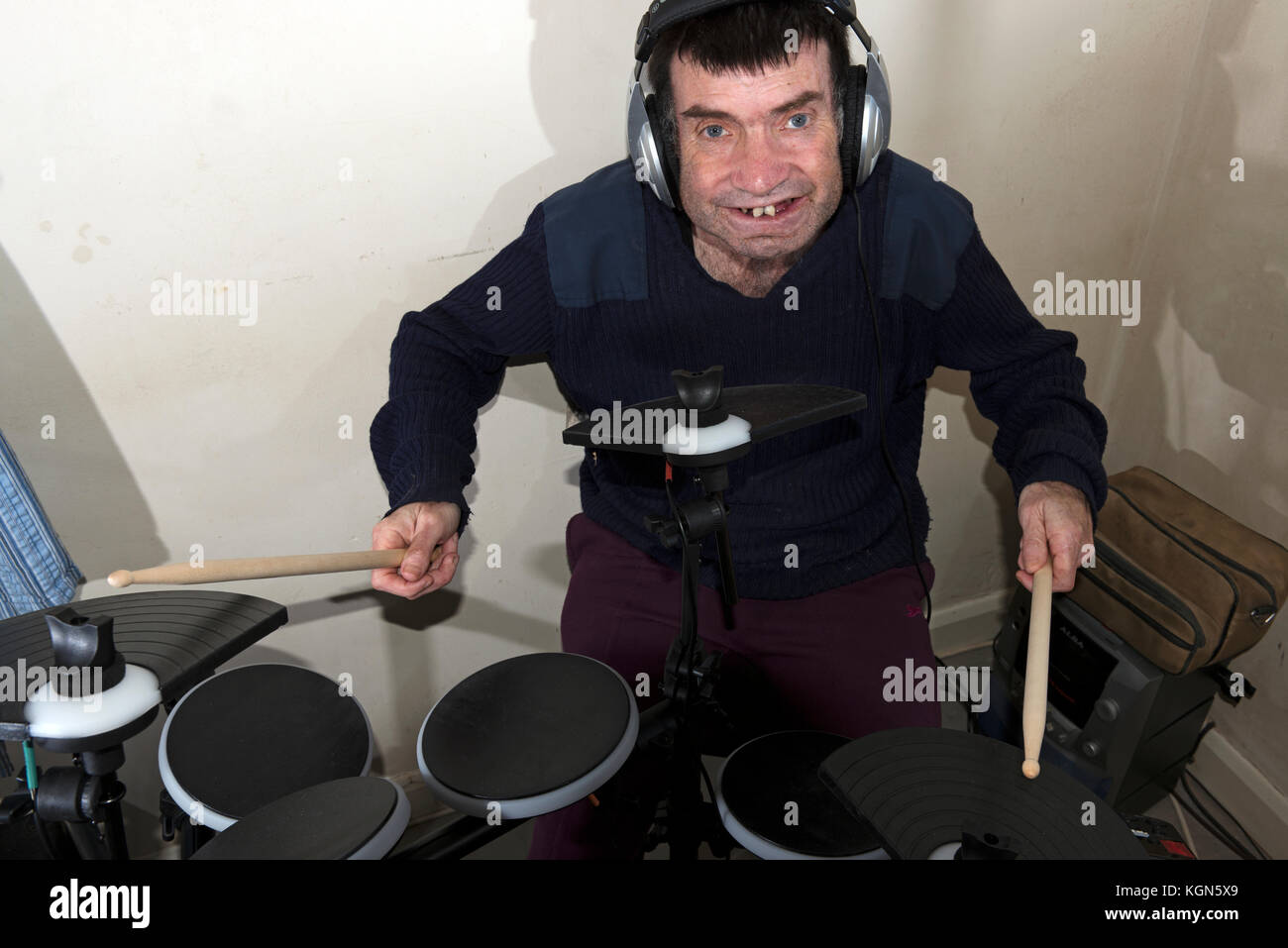 Man with learning disabilities playing electronic drums