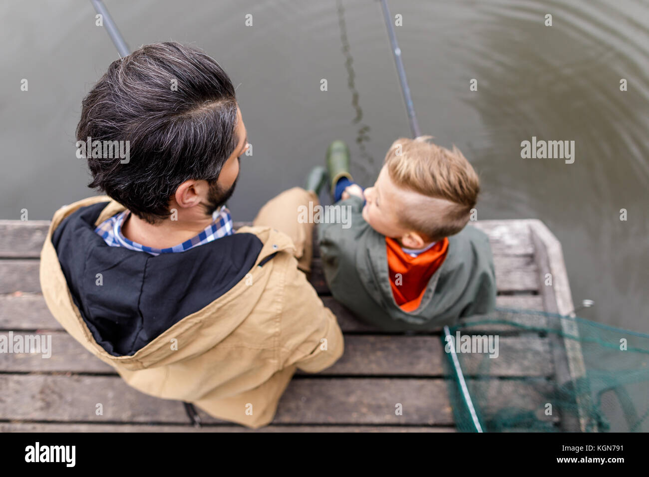 fishing together with rods  - Stock Image