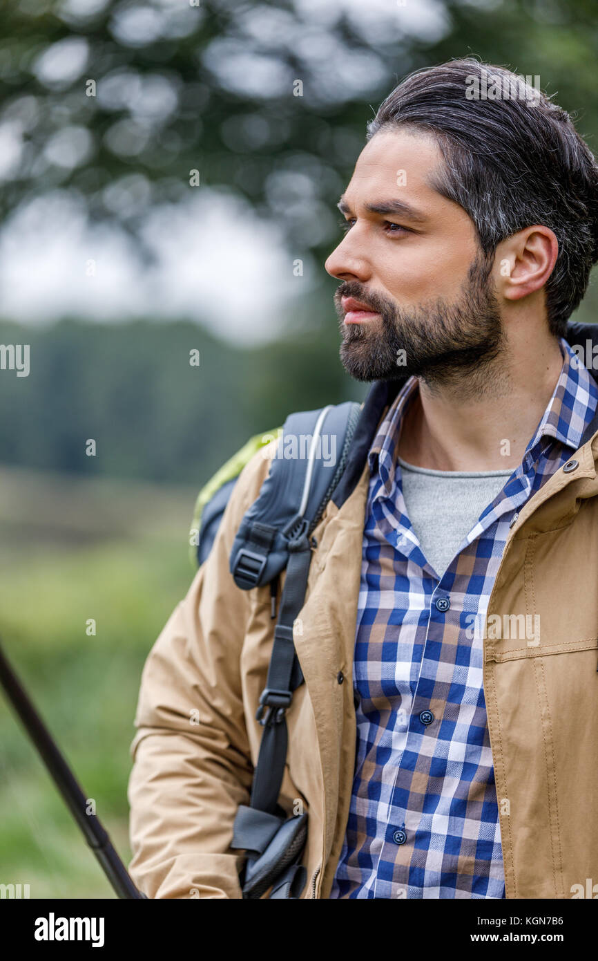 handsome man with backpack - Stock Image