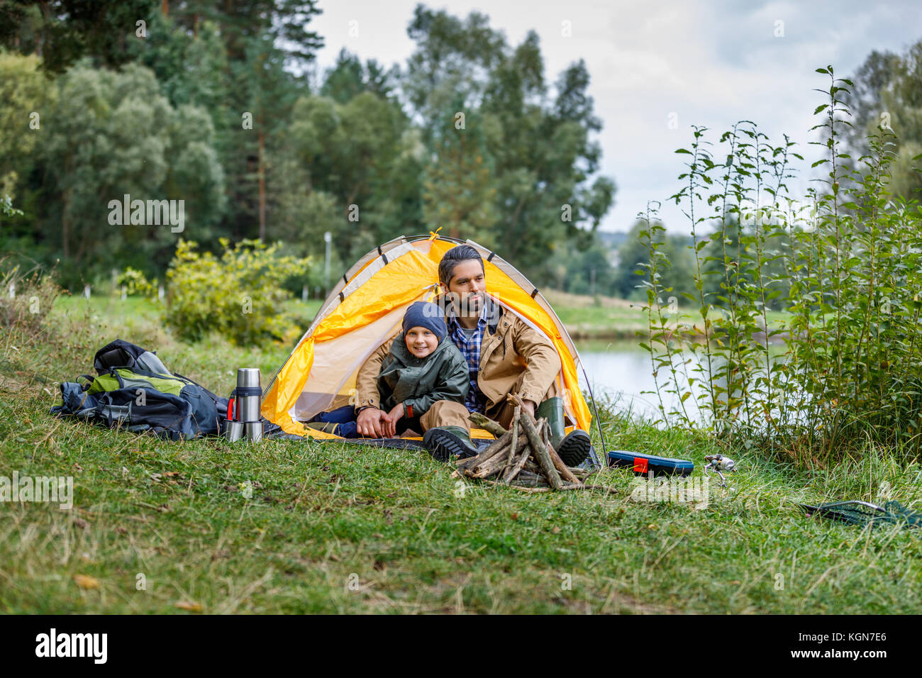father and son in camping at lake - Stock Image