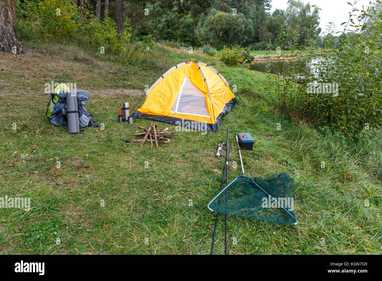 tent on countryside with lake - Stock Image
