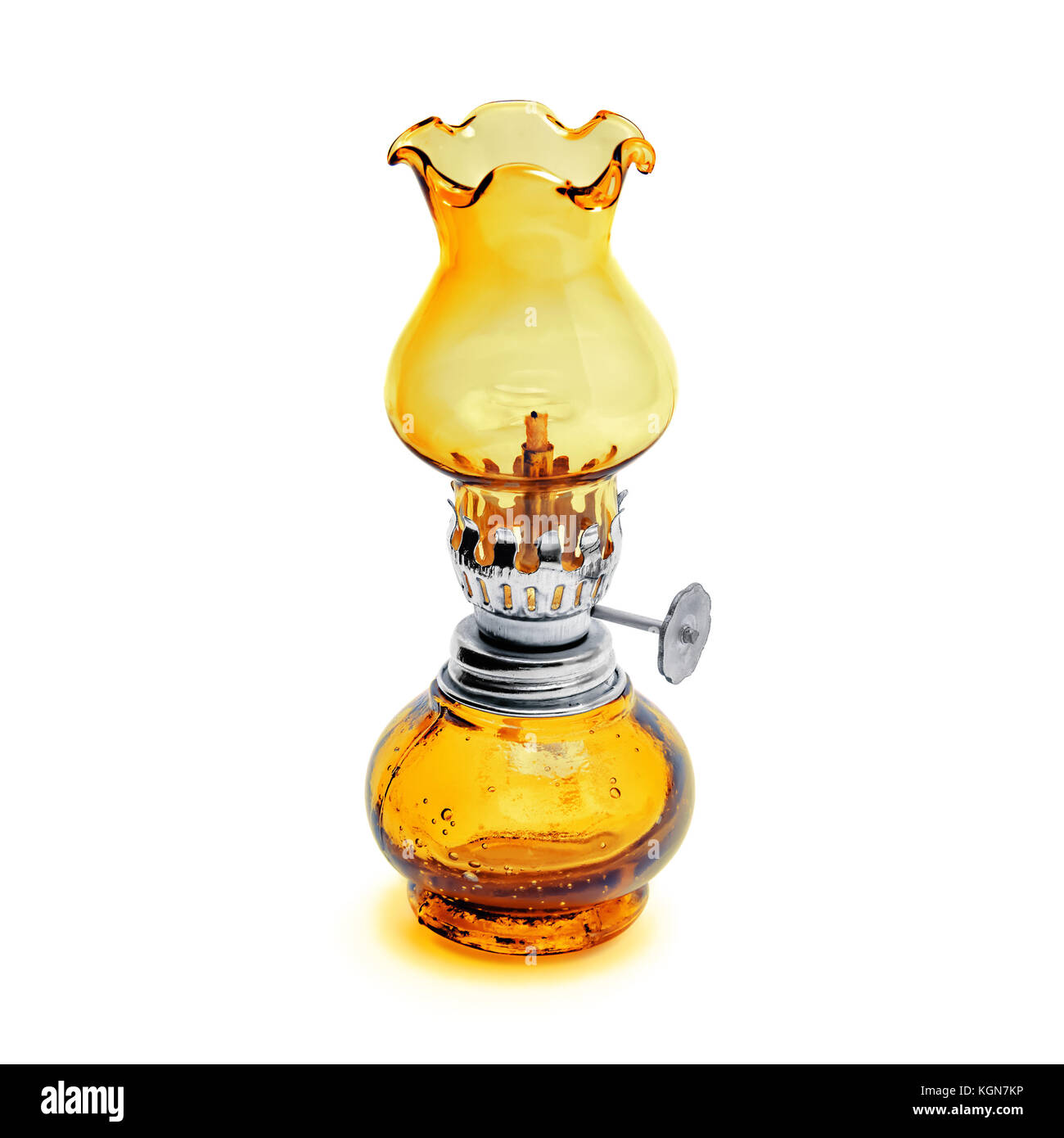 Oil lamp wick lantern made of yellow glass and metal isolated on white background - Stock Image