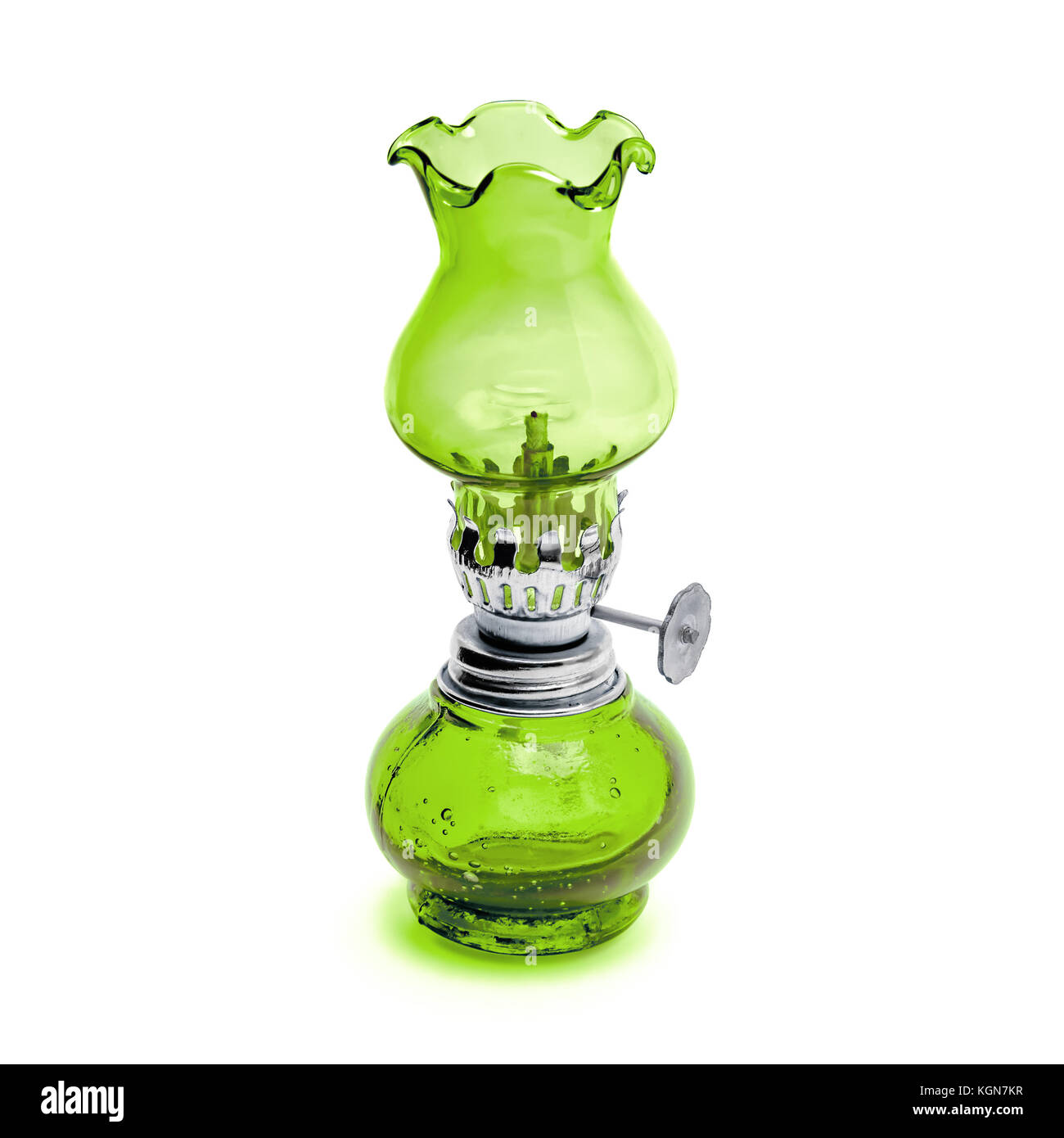 Oil lamp wick lantern made of green glass and metal isolated on white background - Stock Image