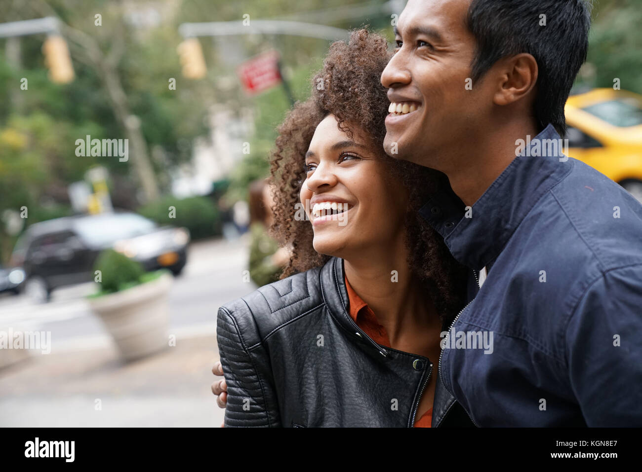 Ethnic couple walking in New york city street - Stock Image
