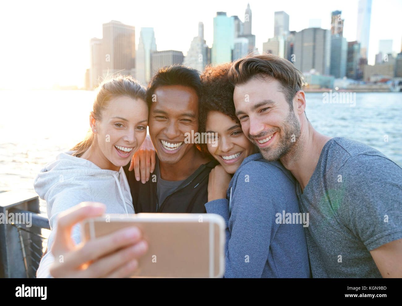 Friends taking selfie picture on Brooklyn heights promenade, NYC - Stock Image