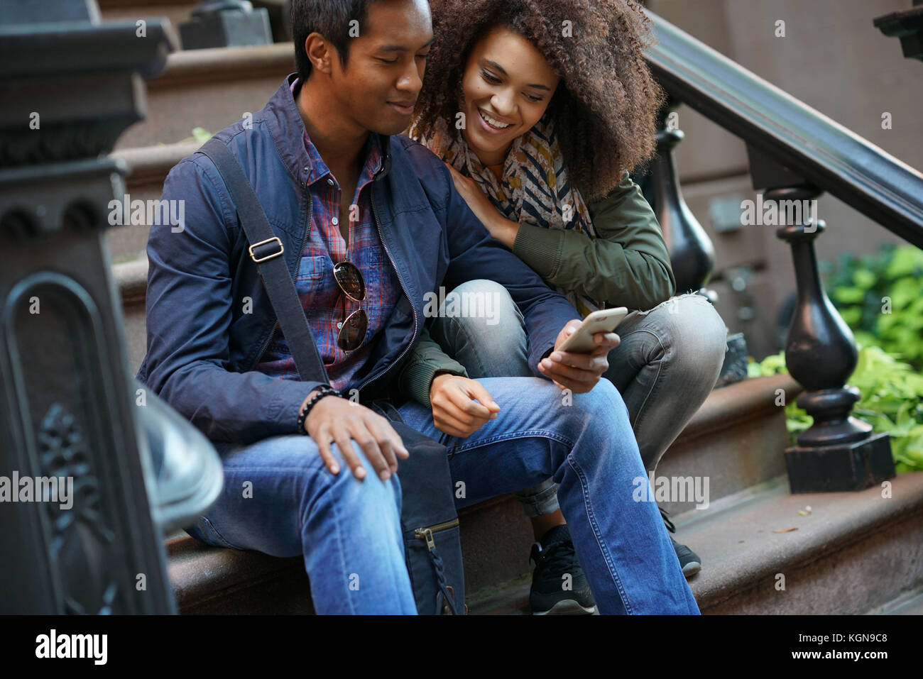 Mixed-race couple taking selfie picture - Stock Image