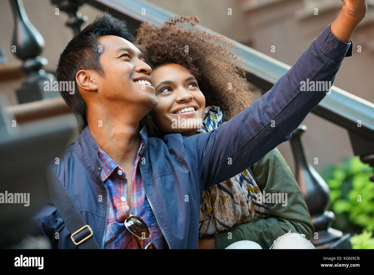 Mixed-race couple taking selfie picture Stock Photo
