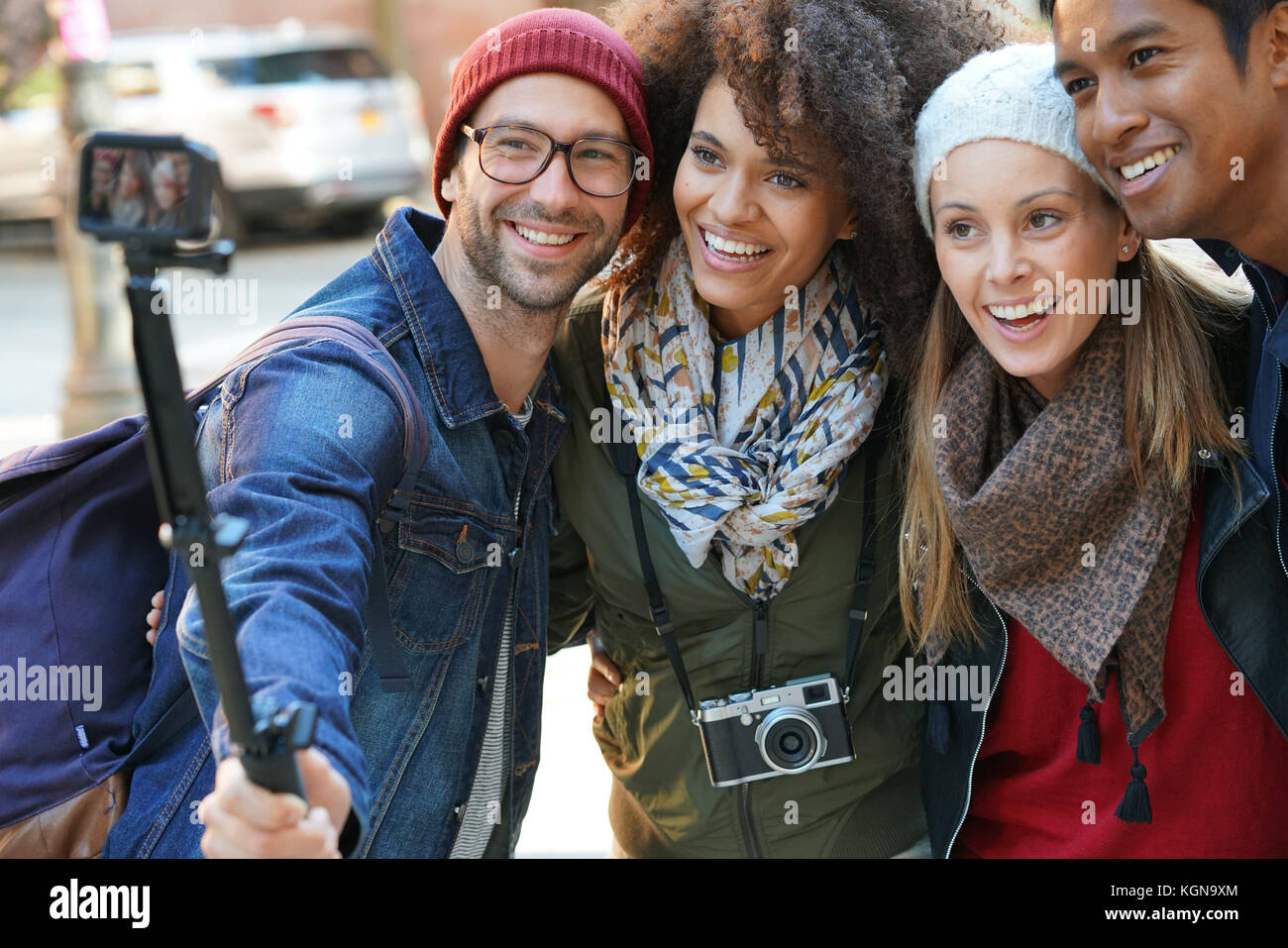 Group of friends on vacation taking selfie picture with camera - Stock Image
