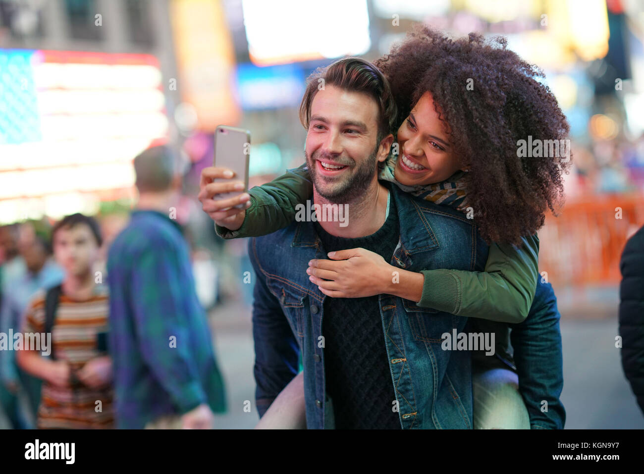 Couple at Times Square taking selfie picture - Stock Image