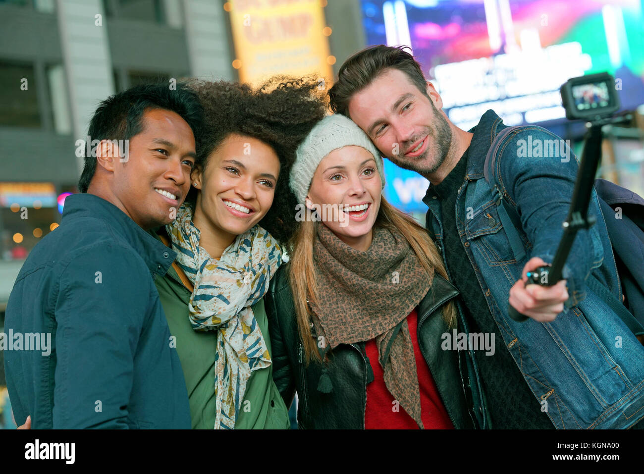 Friends at Times Square taking selfie picture - Stock Image