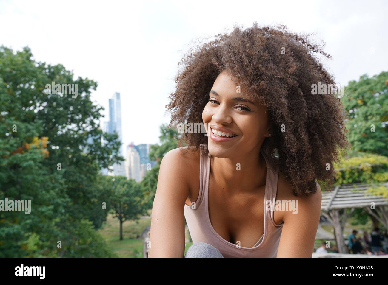 Beautiful woman doing relaxation exercises at Central Park - Stock Image