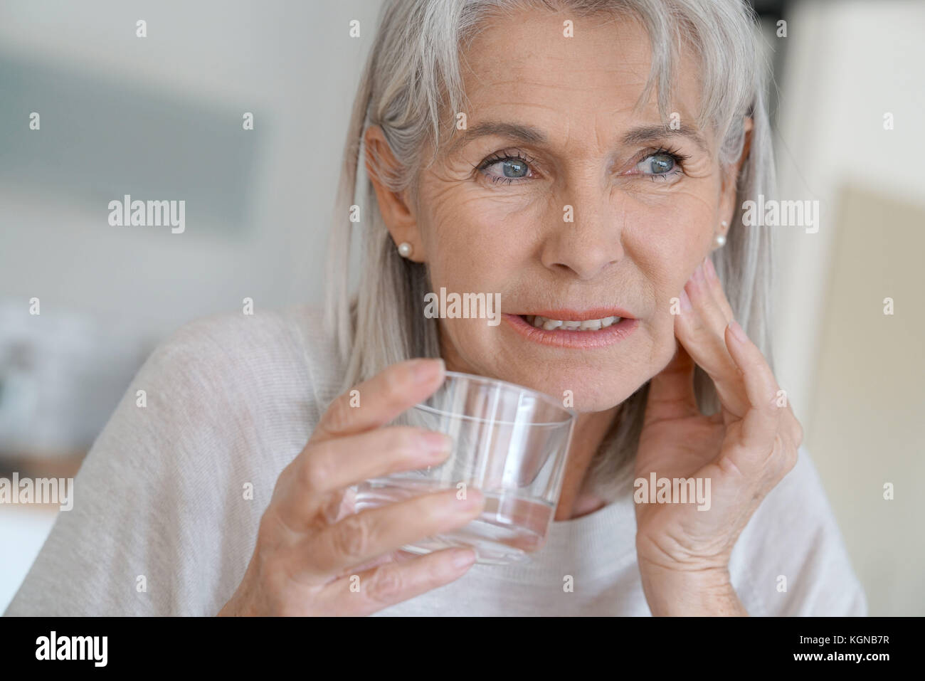 Senior woman with toothache - Stock Image