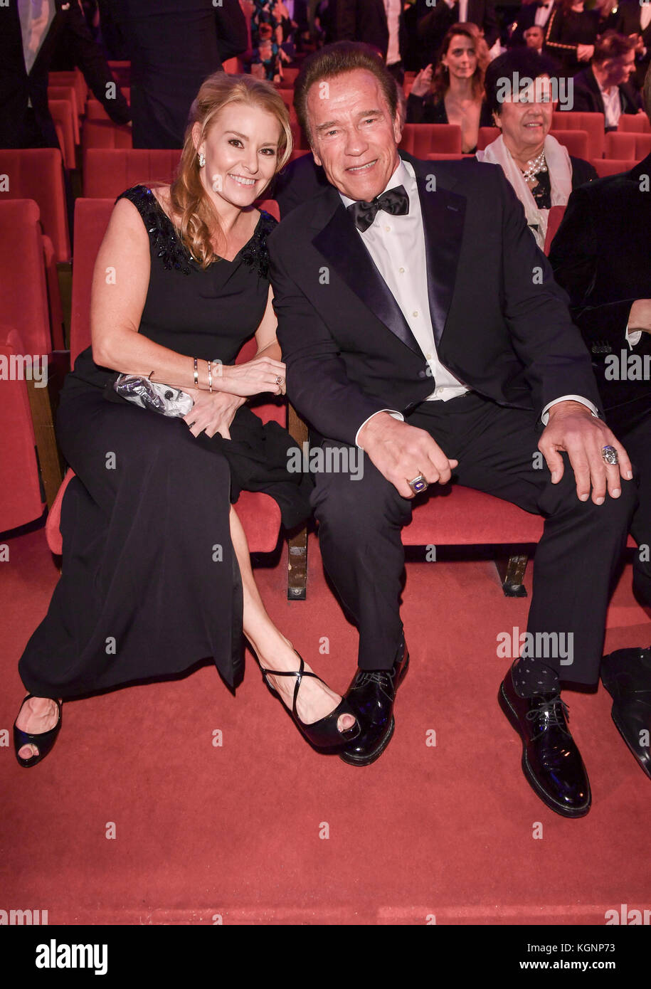 Berlin, Germany. 9th Nov, 2017. Arnold Schwarzenegger (R) and Heather Milligan sit next to each other during the Stock Photo