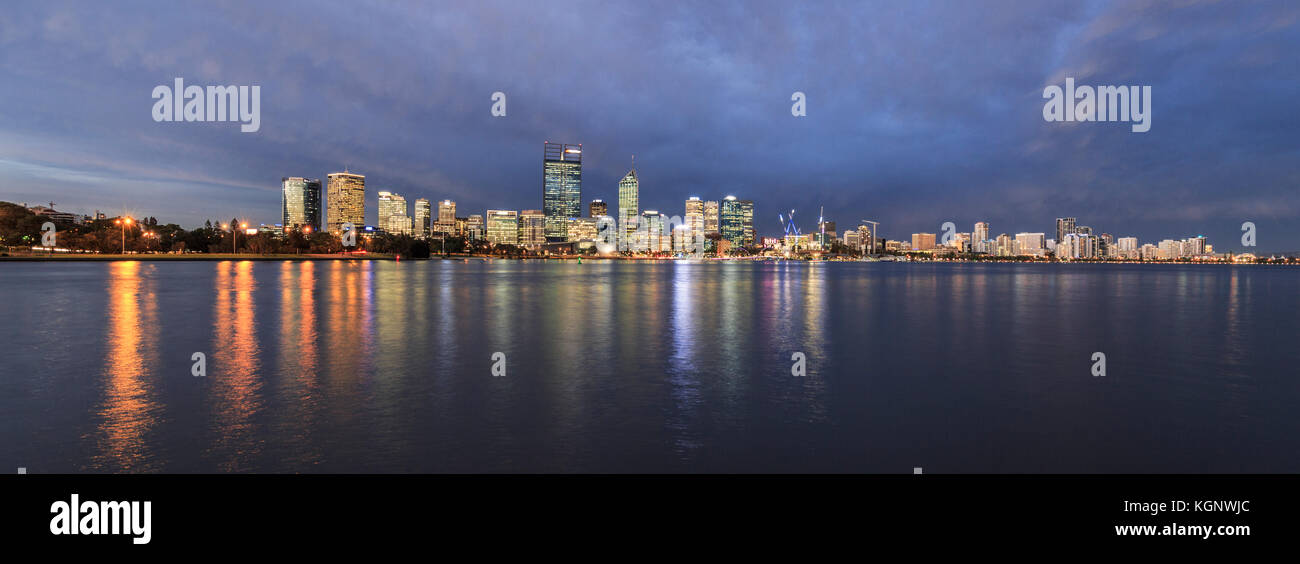 The city reflected in the Swan River at dusk. - Stock Image