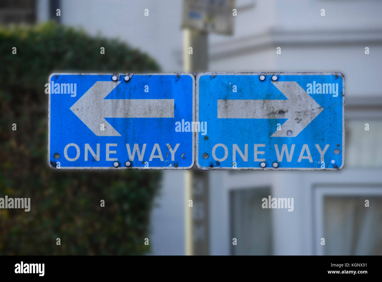Confusing traffic sign with 'one way' pointing in two directions - Stock Image