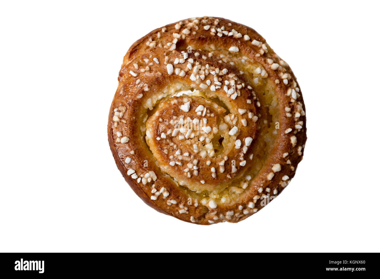 Homemade cinnamon bun decorated with crushed nib sugar isolated on white background. - Stock Image