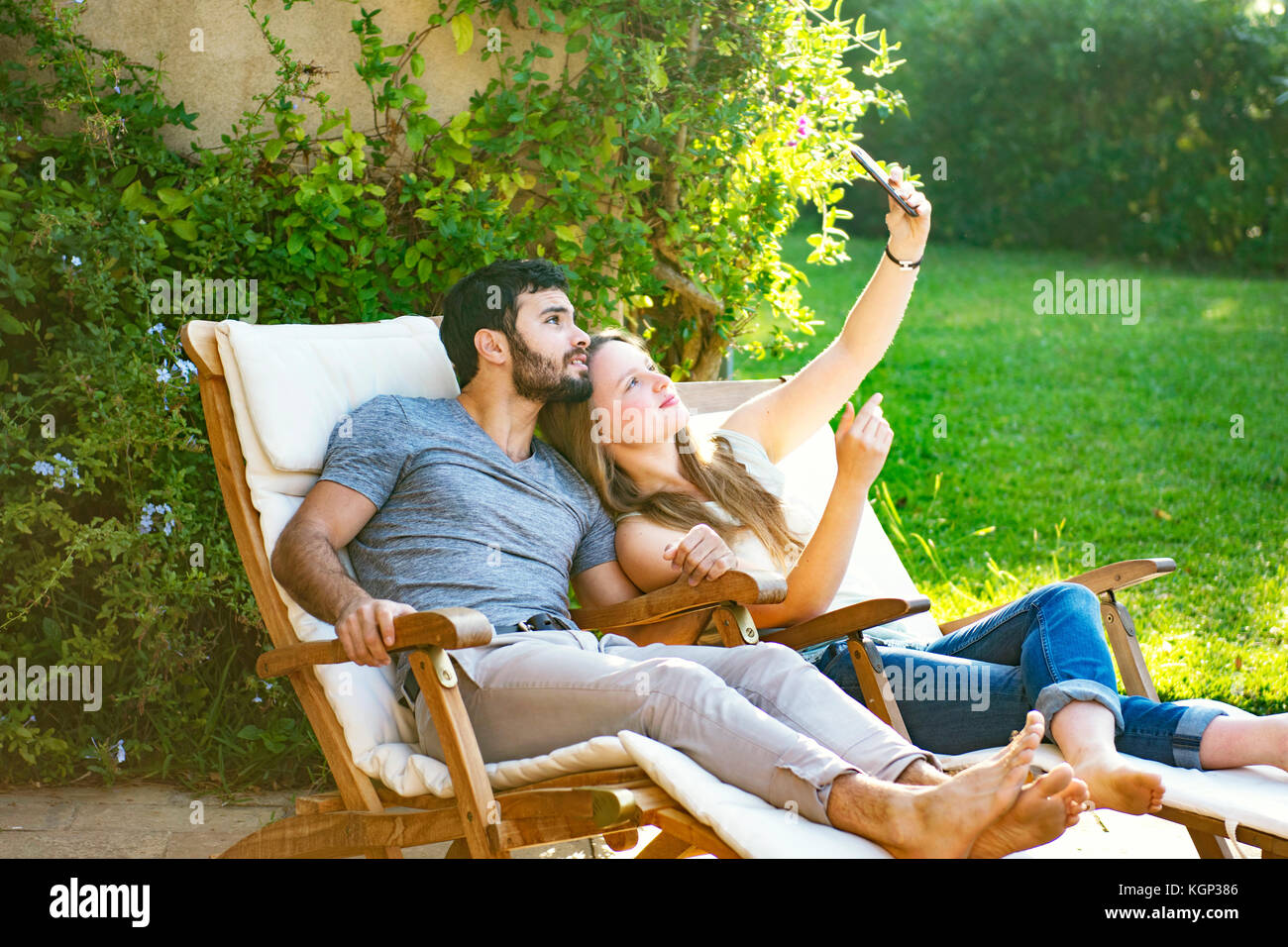 Young couple taking selfies - Stock Image