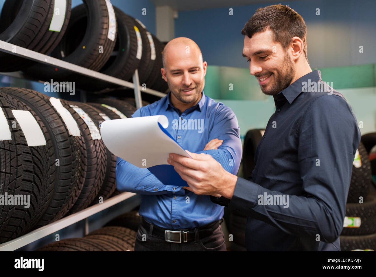 customer and salesman at car service or auto store - Stock Image