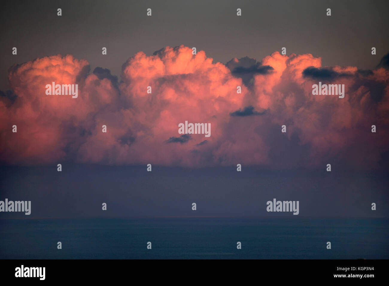 Cumulonimbus clouds over the horizon at the Mediterranean Sea. - Stock Image