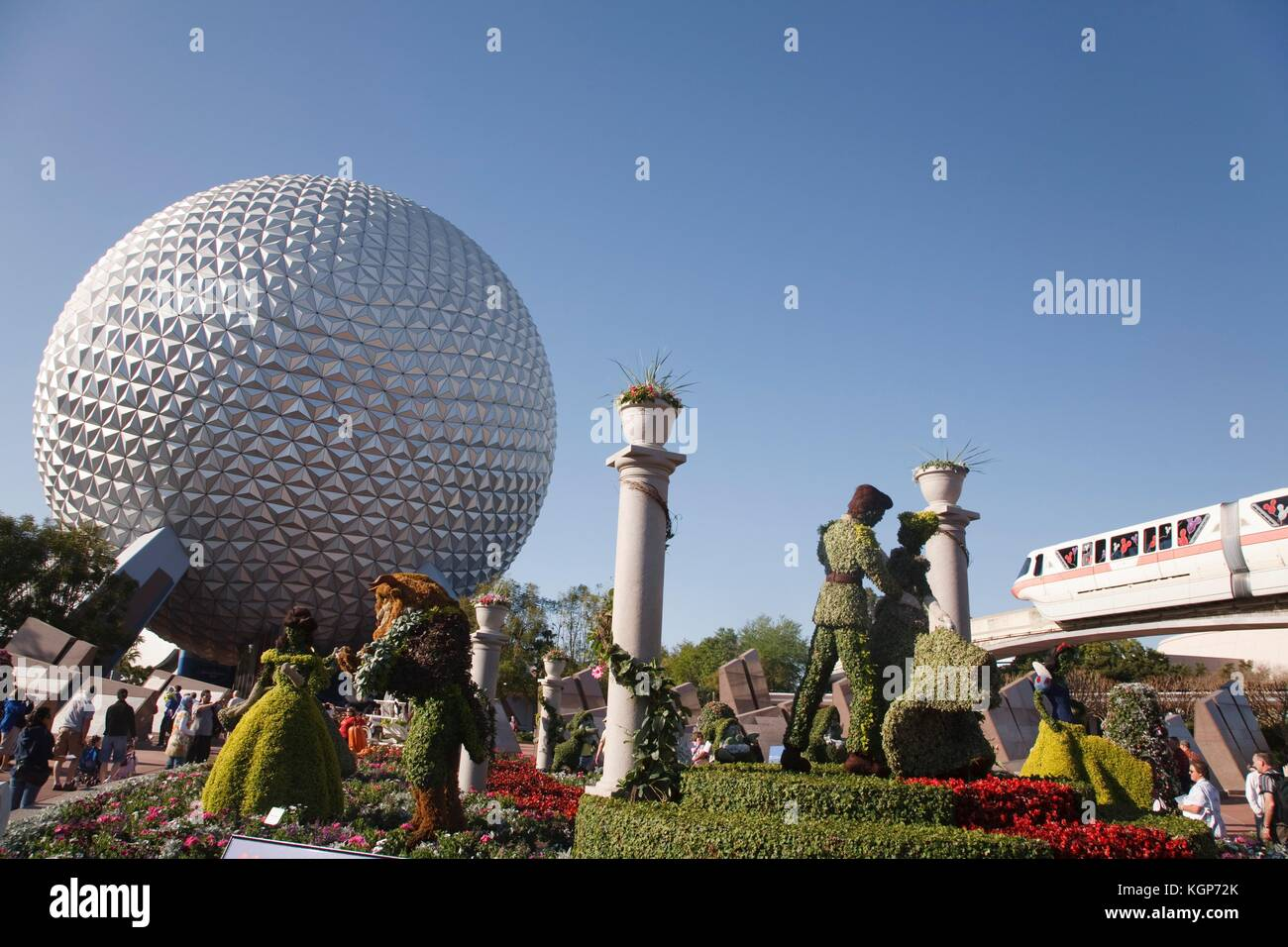 Topiary Disney characters and the Spaceship Earth globe at the Epcot Center, Disneyworld - Stock Image