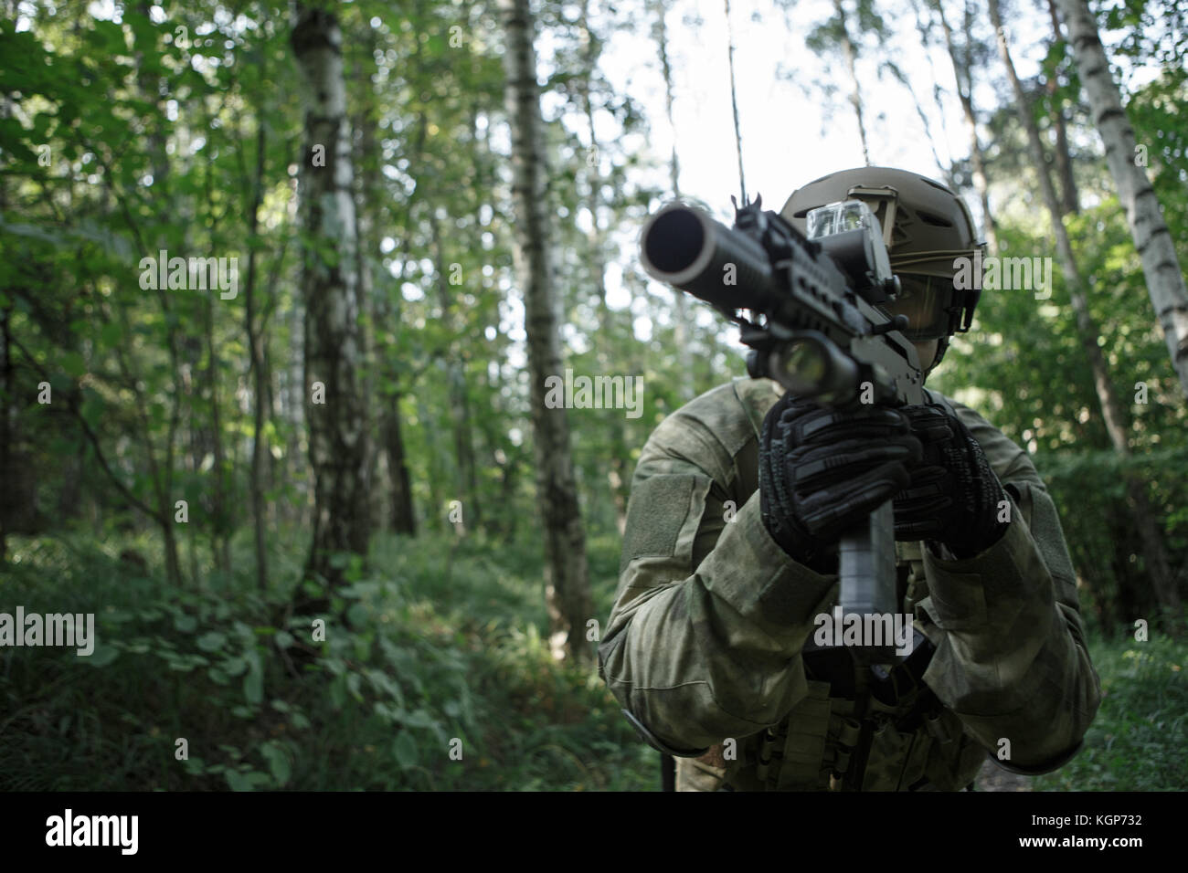 Picture of soldier in helmet with submachine gun - Stock Image