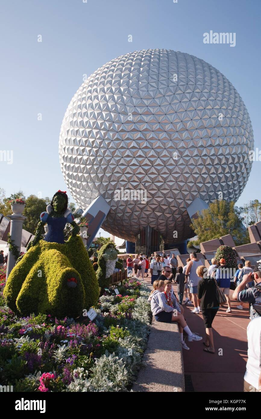Topiary Disney characters and the Spaceship Earth globe at the Epcot Center, Disneyworld, Orlando, Florida - Stock Image