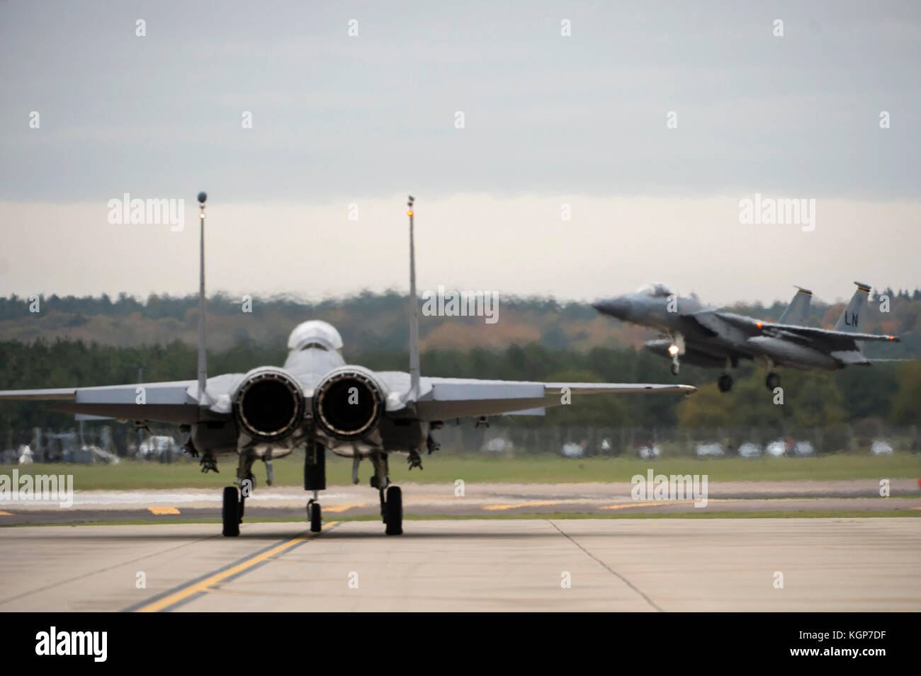 An F-15C Eagle from the 493nd Fighter Squadron, lands on the flight line at Royal Air Force Lakenheath, England, - Stock Image